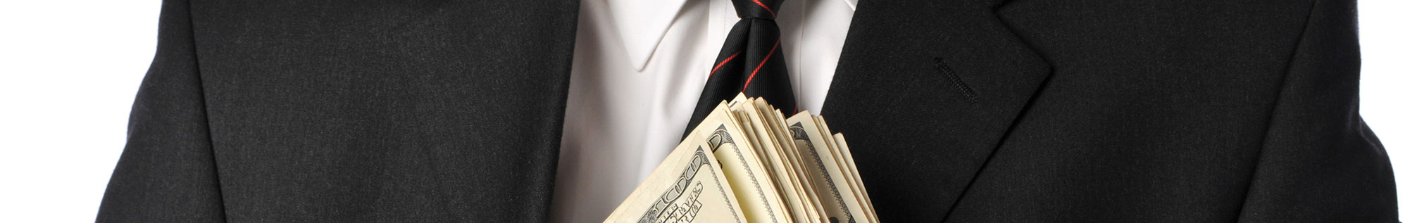 misappropriations - man in suit holding cash